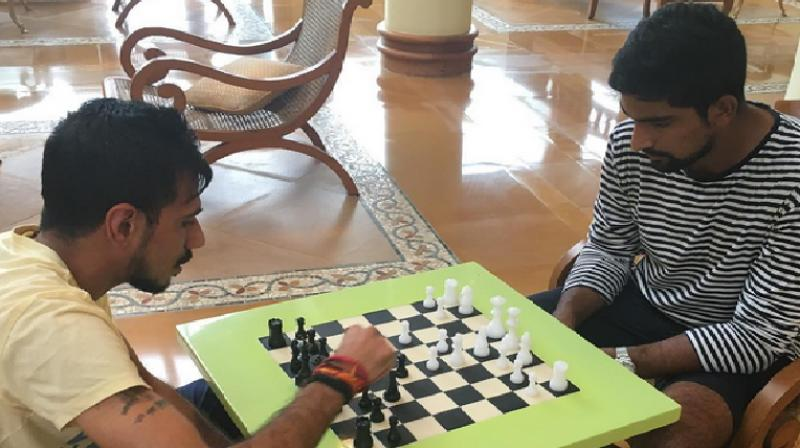 Chahal (left) is a former national level chess player and has represented India at Asian and World Youth championships. (Photo: BCCI Instagram)