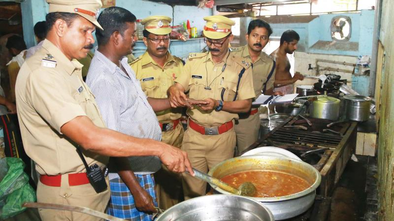 The health squad under the city corporation carrying out inspection at an eatery in Thiruvananthapuram on Tuesday.