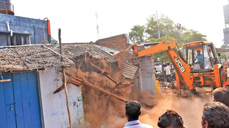 Demolition drive continues in Coimbatore on Monday.