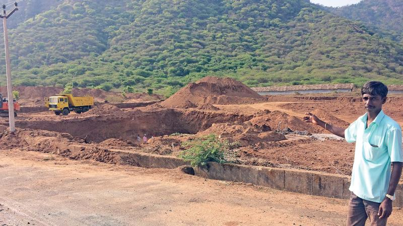 Villagers protest the move of constructing houses by slum clearance board on elephant migratory path near Coimbatore (Photo: DC)