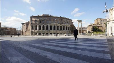A man walks by Teatro Marcello in Rome which is unsually empty due to coronavirus epidemic(AP)