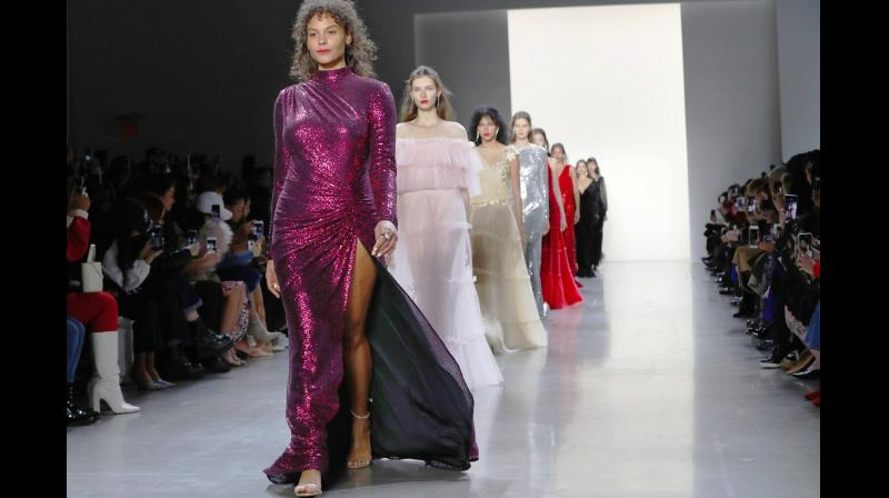 Tadashi Shoji's collection was big on the glam factor with exquisite use of sequins, lace and velvet. (Photo: AP)
