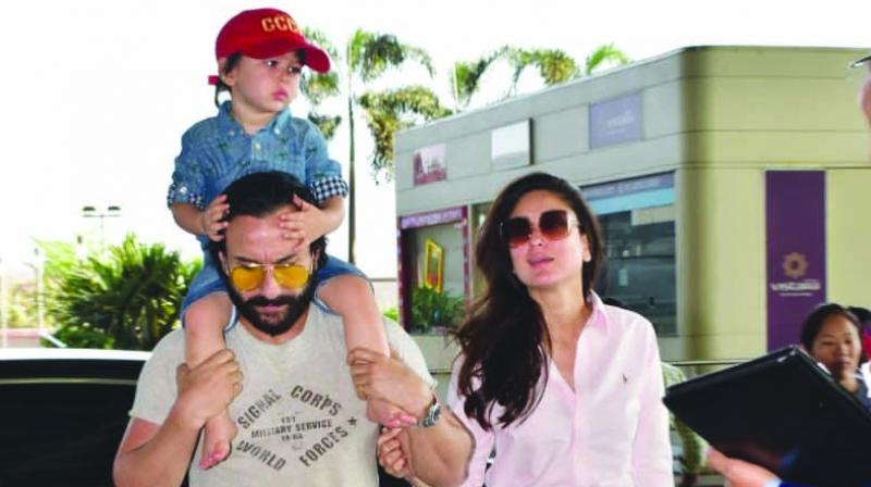 The couple arrived at the airport this morning and Taimur was more than happy to wave at the paps.