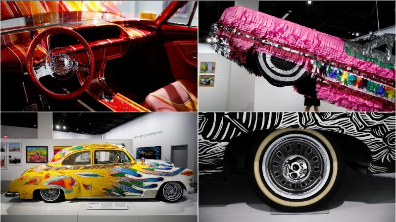 The exhibition 'The High Art of Riding Low' is showcasing lowrider-inspired fine art including paintings, sculptures, serigraphs, photographs, drawings and of course automobiles created by the world's most accomplished Chicano artists. (AP Photo/Jae C. Hong)
