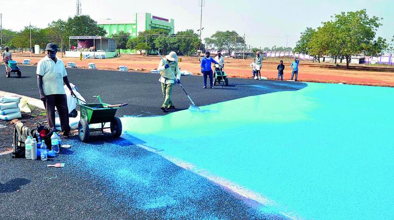 Workers lay the synthetic track in ANU premises on Tuesday. (Photo: DC)