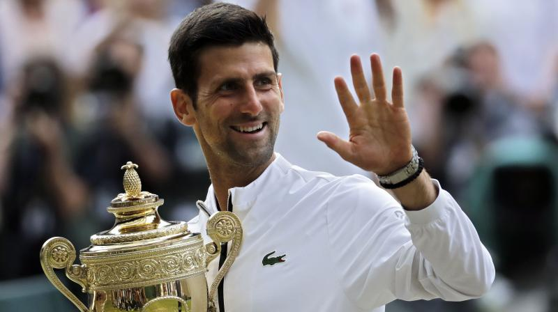Djokovic beats Federer in five-set thriller, clinches fifth