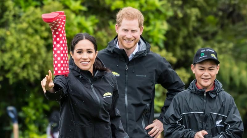 Britain's Meghan, Duchess of Sussex participates in a gumboot throwing competition with Prince Harry after unveiling a plaque dedicating 20 hectares of native bush to the Queen's Commonwealth Canopy project at The North Shore Riding Club in Auckland on October 30, 2018.(Photo: AFP)