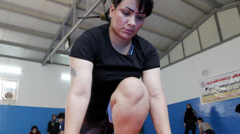 Iraqi female wrestler Alia Hussein attends a training practise at a gym in Diwaniyahh, around 160 kilometres (100 miles) south of the capital Baghdad, on October 7, 2018. - Taking on a sport largely reserved for men, Iraq's first women's wrestling squad grapples in the ring but it also wrangles with strict traditions in the country's tribal south.(Photo: AFP)