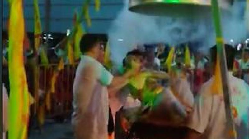 Lim Ba, 68, suffered a heart attack and burns after attempting to perform the elaborate ritual during a Taoist festival at a Chinese temple. (Photo: Video screengrab Facebook/黄民友)