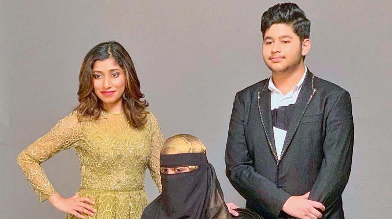 Raheema, Khatija and Ameen pose for Hello magazine's debutante ball.