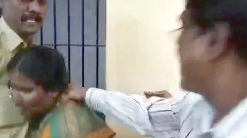 A video grab of the attack on a woman at the Kumaraswamy Layout police station.