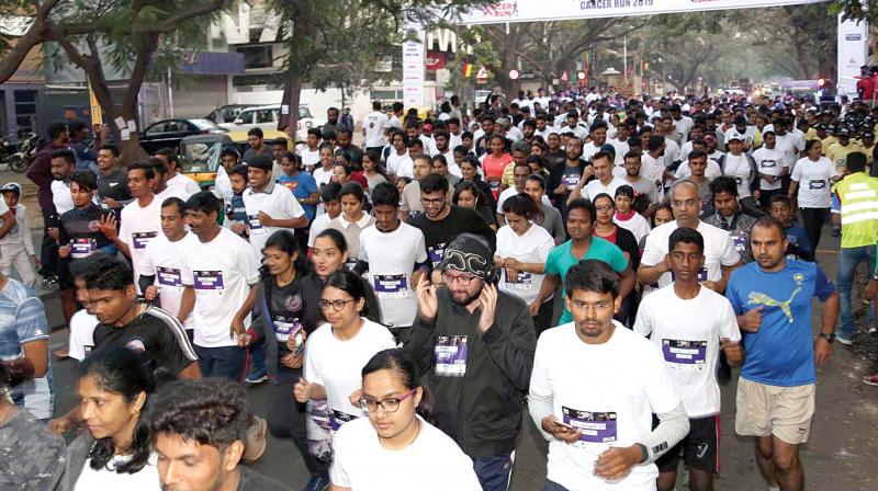 People take part in Cancer Day walkathon organised at Indiranagar in Bengaluru on Sunday (Photo: KPN)