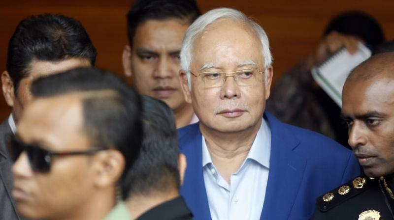 Former Malaysian PM Najib Razak faces dozens more corruption charges