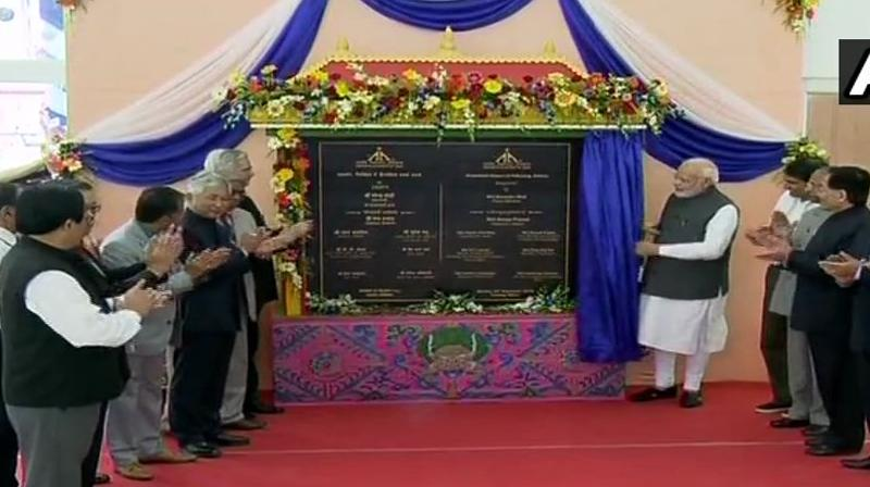 PM Modi was accompanied by Chief Minister Pawan Chamling and Union Aviation Minister Suresh Prabhu as he unveiled the plaque, formally inaugurating the aero facility. (Photo: Twitter | @ANI)