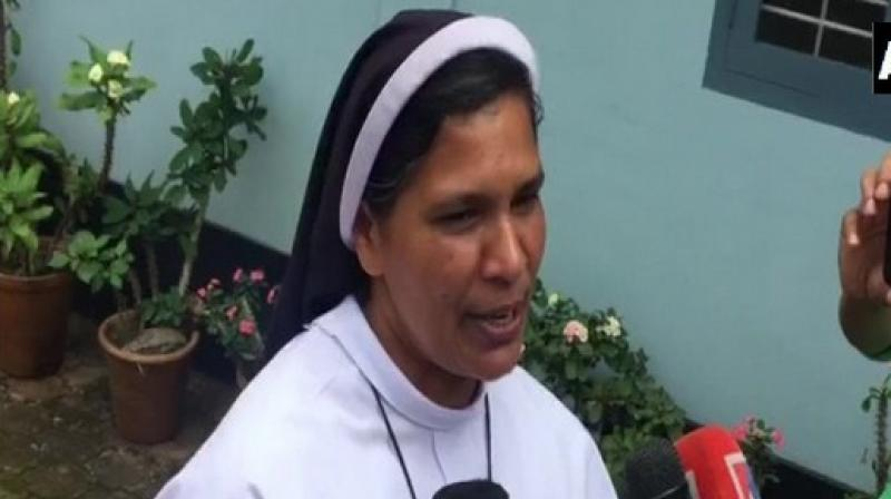 Sister Lucy, who joined a number of others outside the Kochi High Court to stage a protest against the rape-accused Bishop, was reportedly barred from her duties and relieved from church activities on Sunday. (Photo: ANI)