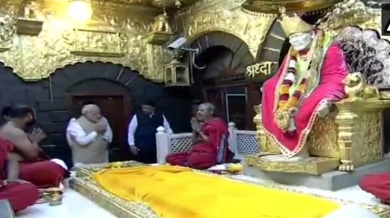 PM Modi visits Shirdi temple, hands over keys to PMAY-G