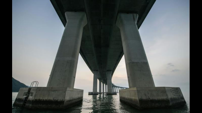 The 55-kilometer crossing, which includes a snaking road bridge and underwater tunnel, links Hong Kong's Lantau island to Zhuhai and the gambling enclave of Macau, across the waters of the Pearl River Estuary. (Photo: AFP)