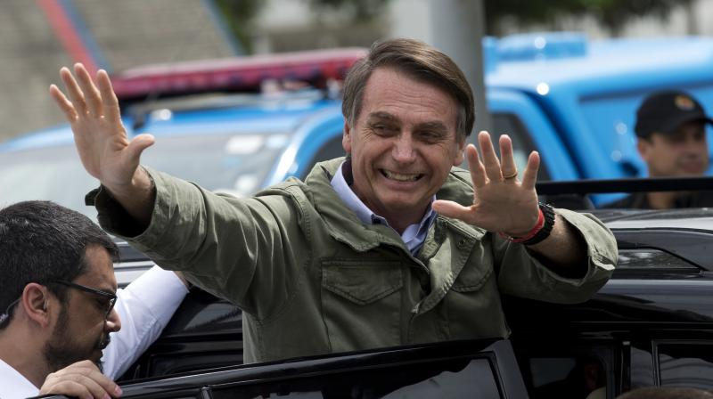 Jair Bolsonaro, waves after voting in the presidential runoff election in Rio de Janeiro in Brazil on Sunday, October 28, 2018. (Photo: AP)