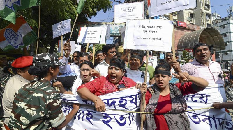 Assam Pradesh Congress Committee (APCC) activists take part in a protest against the killing of innocent people in Tinsukia District of Assam on Friday evening, in front of Rajiv Bhawan in Guwahati. (Photo: PTI)