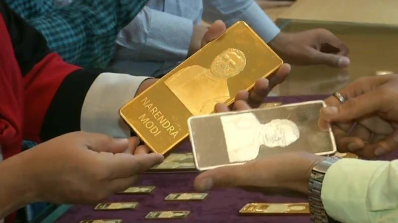 A jewellery shop in Surat has attracted customers by selling gold and silver bars with imprints of PM Modi and former PM late Atal Bihari Vajpayee. (Photo: ANI)
