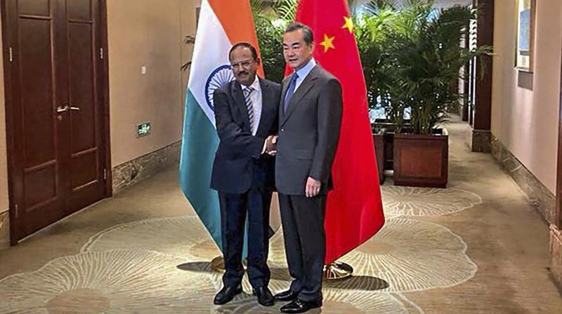 National Security Advisor, Ajit Doval shakes hands with Chinese Foreign Minister, Wang Yi ahead of the 21st round India-China Border talks at Dujiangyan city, in Sichuan province of China, Saturday, November 24, 2018. (Photo: PTI)