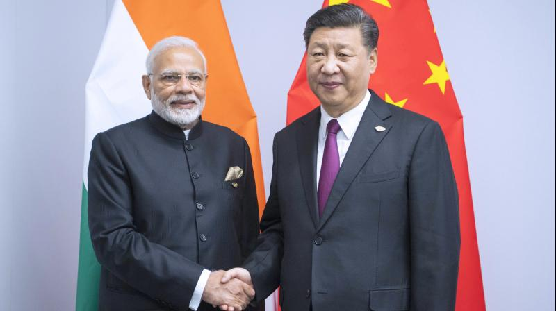Photo released by China's Xinhua News Agency shows Chinese President Xi Jinping, right, shaking hands with Indian Prime Minister Narendra Modi during a meeting on the sidelines of the G20 summit in Buenos Aires, Argentina, on November 30, 2018. (Photo: AP)