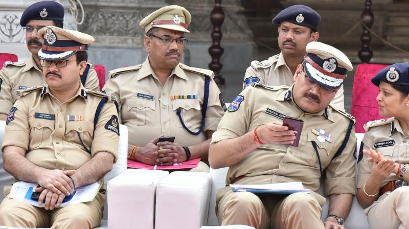 Hyderabad commissioner of police, Anjani Kumar in conversation with IGP women's safety Shikha Goel, as Anil Kumar, additional commissioner (traffic) looks on at Chowmahalla Palace on Wednesday. — Style photo service