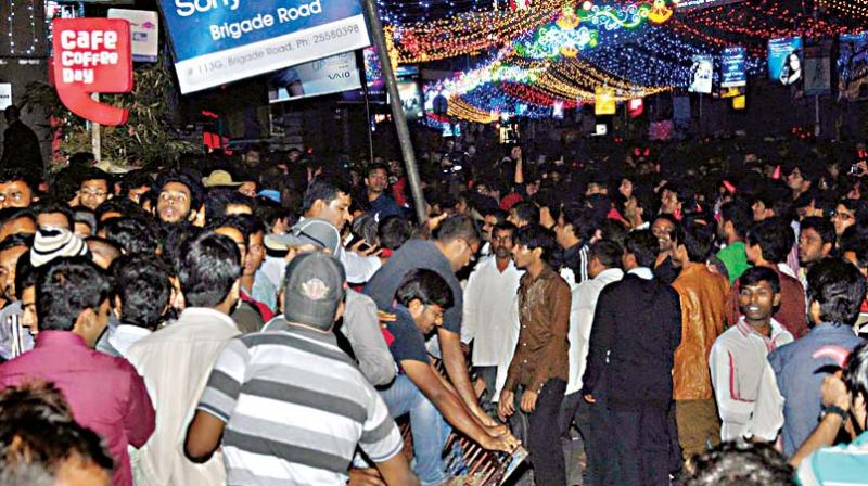 A file photo of people gathered on Brigade Road to celebrate on the eve of New Year in Bengaluru	—KPN