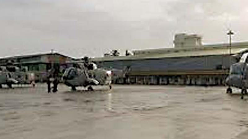 Initial reports had said the two were killed when the hangar collapsed on them.