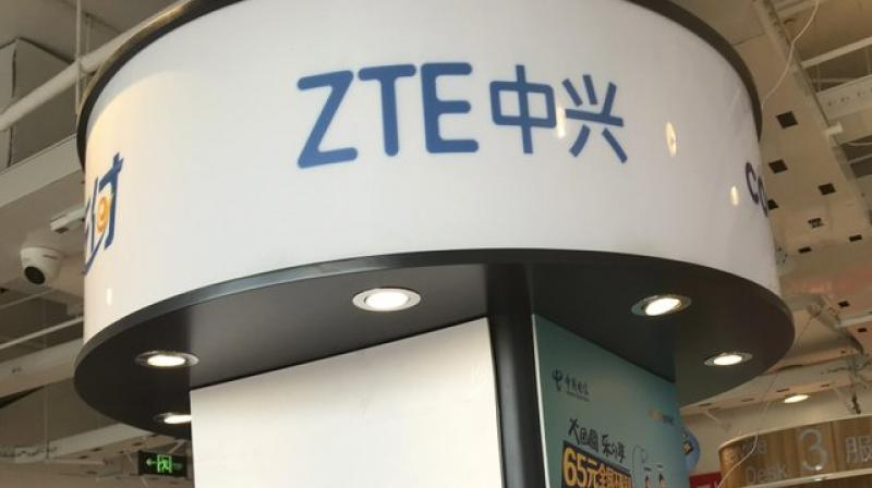 ZTE's logo is seen in a telecommunication services shop in Beijing Wednesday, July 4, 2018. Tech giant ZTE Corp.'s near-death experience after Washington barred it from buying US components was a stark reminder that China's industry leaders cannot function without American technology. (AP Photo/Ng Han Guan)