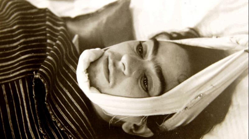 This 1940 photo provided by Sotheby's shows artist Frida Kahlo with her head suspended by straps, is a part of the photographs by Nicholas Muray up for auction. (Photo: AP)