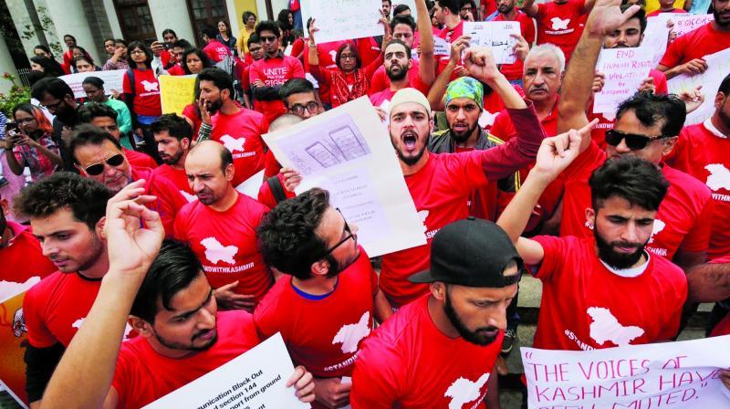 Kashmiris living in Bengaluru protest against the blockade of communication in Kashmir on Saturday.  (PTI)