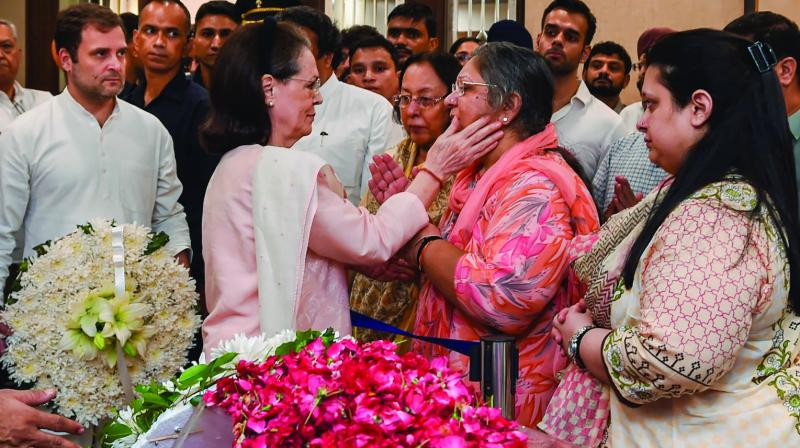 Congress president Sonia Gandhi consoles family members of former finance minister and BJP leader Arun Jaitley as party leader Rahul Gandhi looks on, at Greater Kailash, New Delhi on Saturday.  (PTI)