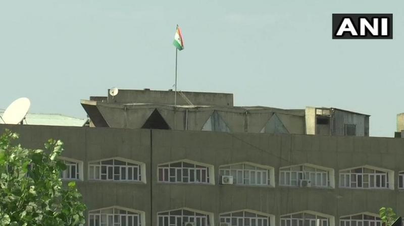 National flag adorns at Civil Secretariat building in Srinagar. (Photo: ANI)