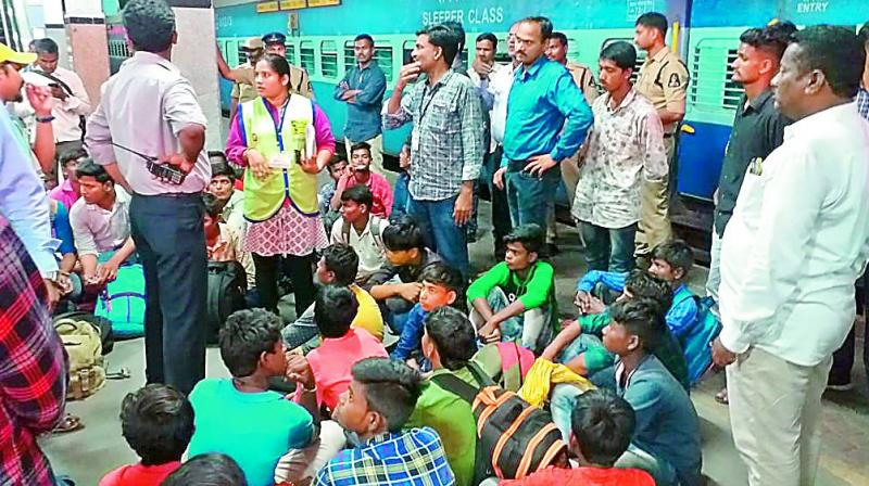Children who were rescued from trafficking waiting at a railway station on Wednesday.