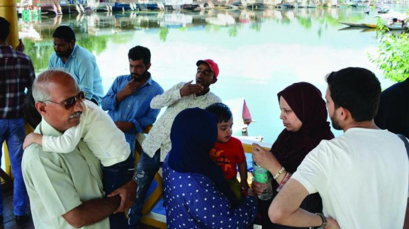 Tourists and Amarnath Yatris leave from the valley after government issued security advisory to curtail stay in Kashmir in Srinagar on Saturday. (Photo: PTI)