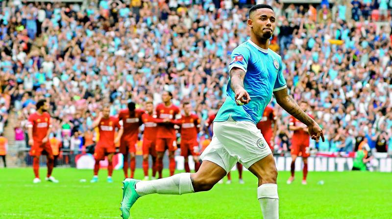 Manchester City's Brazilian striker Gabriel Jesus celebrates after converting the winning penalty in the shoot-out of the English Community Shield football match at Wembley Stadium in London on Sunday. (AFP)