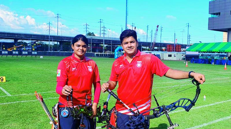 Jyothi Surekha (left) and Abhishek Verma are all smiles after winning gold in the mixed pair event at the 21st Asian Archery Championships held in Bangkok on Wednesday. The Indians beat their Chinese Taipei opponents Yi-Hsuan Chen and Chieh-Luh Chen 158-151 in the title match.