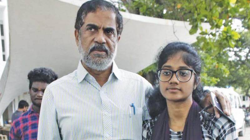Abdul Latheef with his daughter Ayisha Latheef, Fathima's twin  sister outside Crime Branch Police.