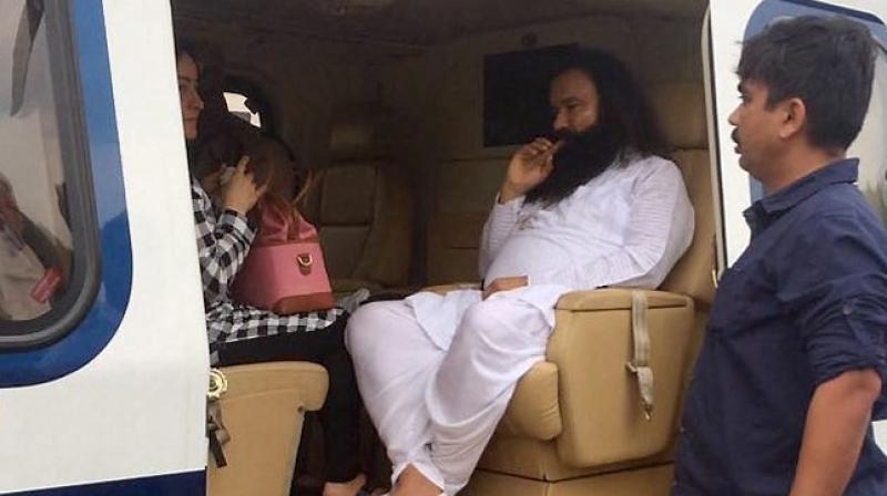 Both sentences will run consecutively for a total of 20 years in jail for the flamboyant guru who has millions of followers. (Photo: PTI)