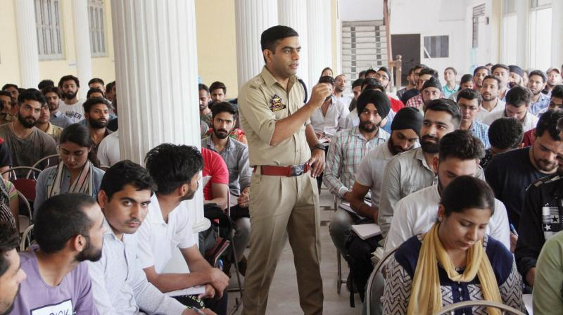 Superintendent of Police (South Jammu) Sandeep Chaudhary gives free coaching to the students preparing for various examinations including Civil Services. (Photo: PTI)