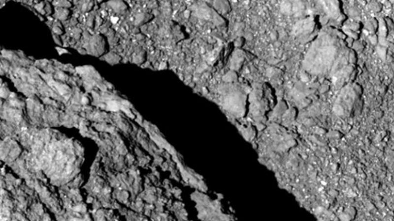 Japan space agency scientists and engineers are thrilled by the images being sent to Earth by two jumping robotic rovers that they dropped onto an asteroid about 280 million kilometers (170 million miles) away. (Photo: AP)