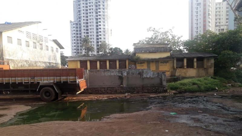 The dilapidated comfort station at Aluva