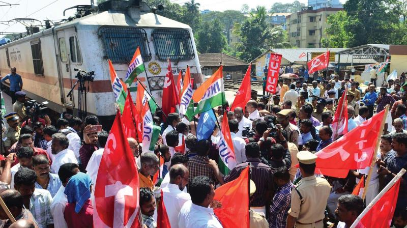 Various trade union members block train as part of the national strike at Kottayam railway station, Wednesday.