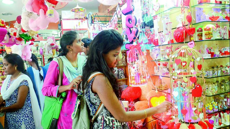 Valentines day youth fear attacks by bajrang dal youngsters check out gift articles at a shop in visakahapatnam on the eve of valentines day negle Choice Image