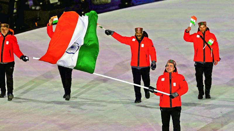 Shiva Keshavan carries the Indian flag during the opening ceremony of the Winter Olympics in Pyeongchang, South Korea, on Friday. (Photo: Ap)