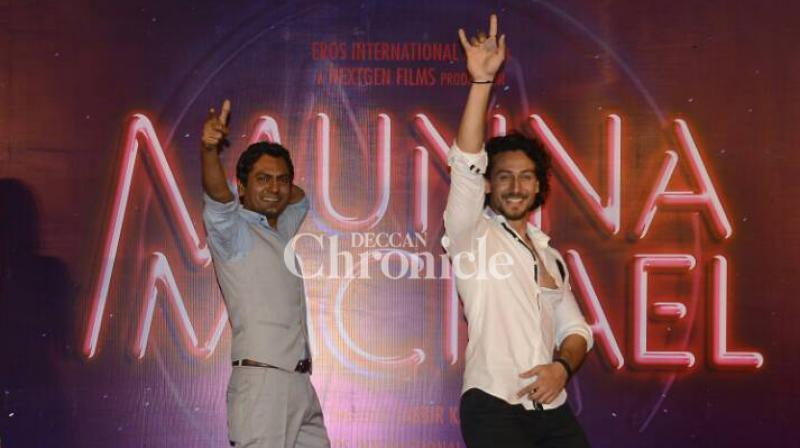 Tiger Shroff and Nawazuddin Siddiqui enjoyed themselves by grooving together as they launched the trailer of their film 'Munna Michael' in Mumbai on Monday. (Photo: Viral Bhayani)