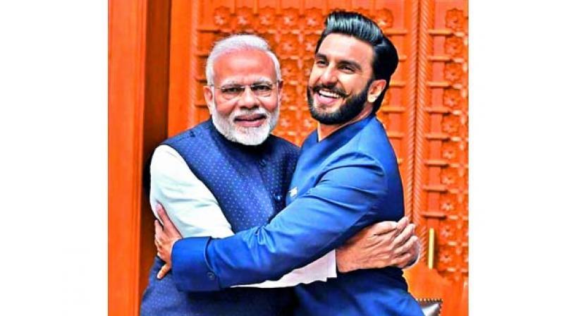 "Image uploaded by Ranveer Singh with PM Modi, captioned, ""Jaadoo ki Jhappi! Joy to meet the Honourable Prime ... (sic)"""
