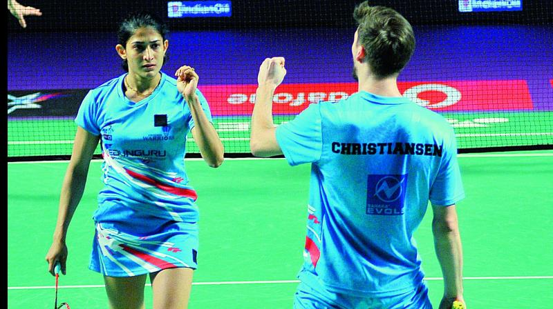 Ashwini Ponnappa (left) & Mathias Christiansen of the Awadhe Warriors celebrate their mixed doubles win over Marcus Ellis & Lauren Smith of Bengaluru Raptors.