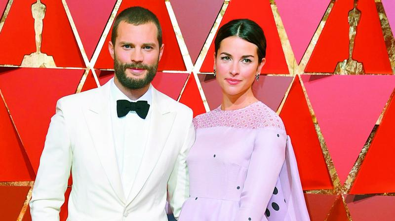 Jamie Dornan's wife Amelia Warner hasn't watched him in any of the Fifty Shades Of Grey films.